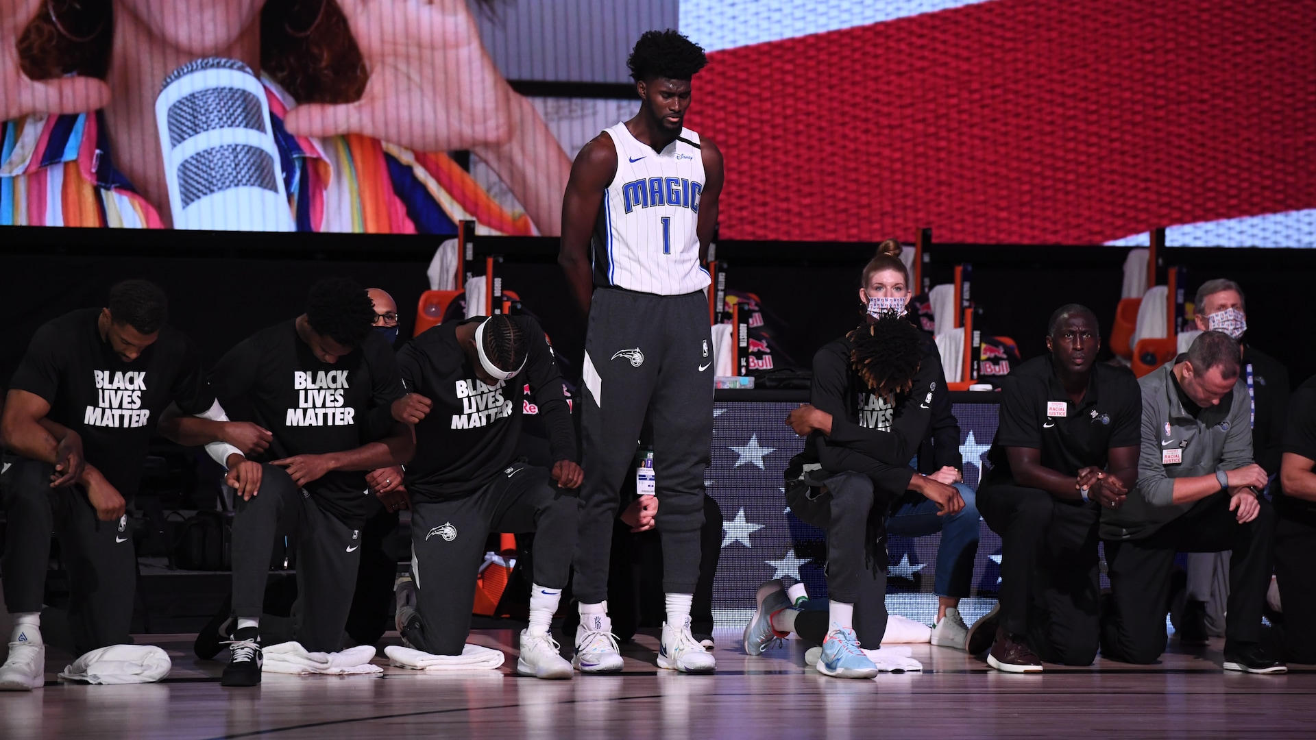 Spurs coach Gregg Popovich, Magic's Jonathan Isaac stand for anthem
