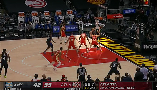 Gibson with two defenders