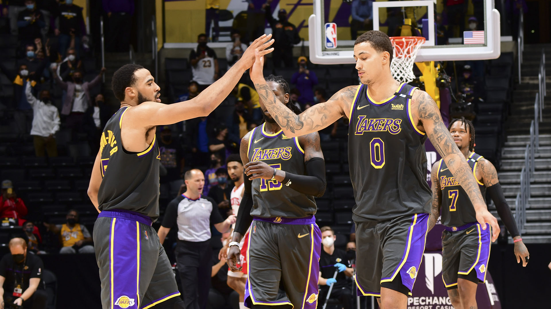 Short-handed Lakers hold off Rockets on banner night