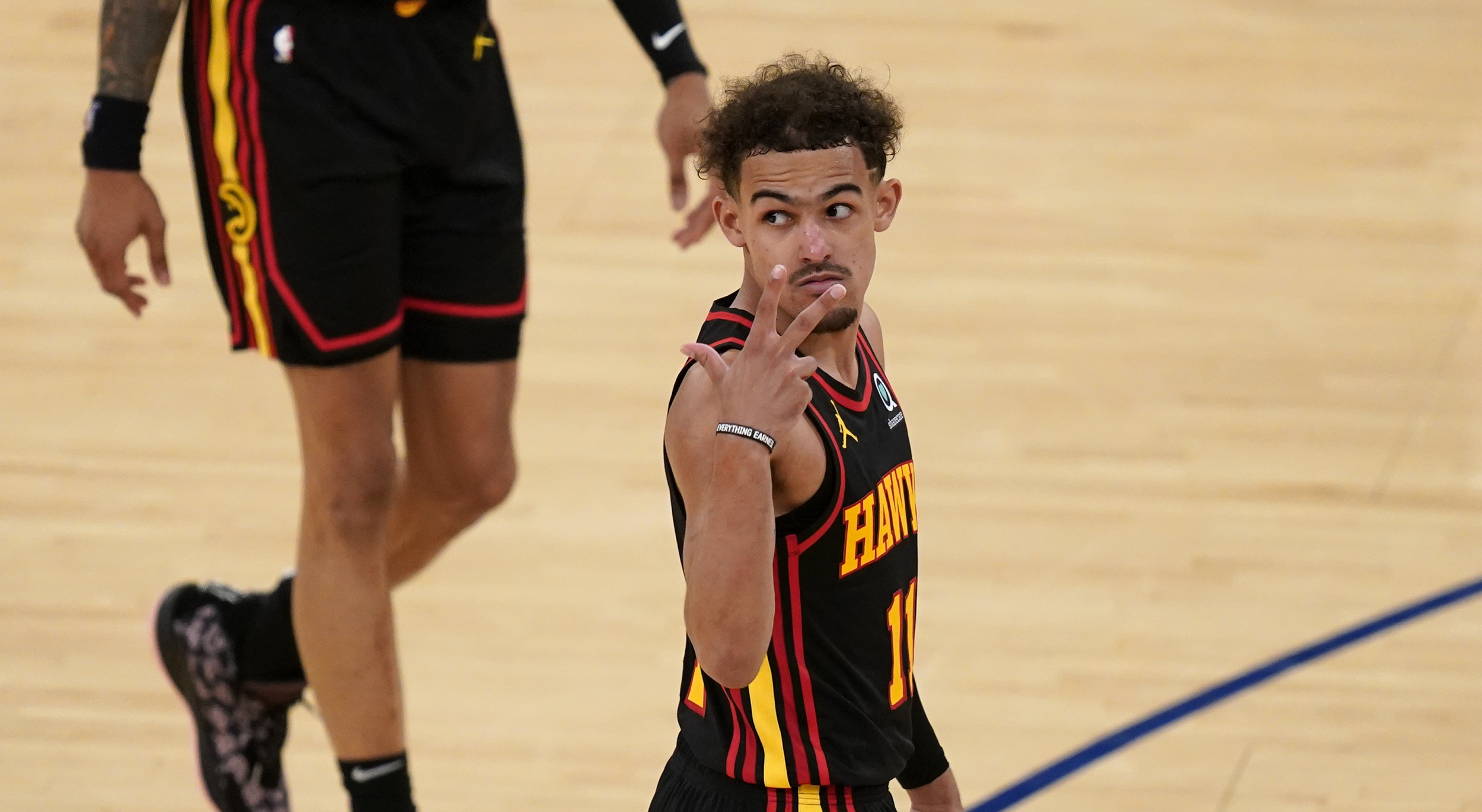 Trae Young embraces moment in playoff debut