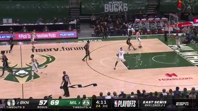 Middleton connects with Giannis for two-hand dunk