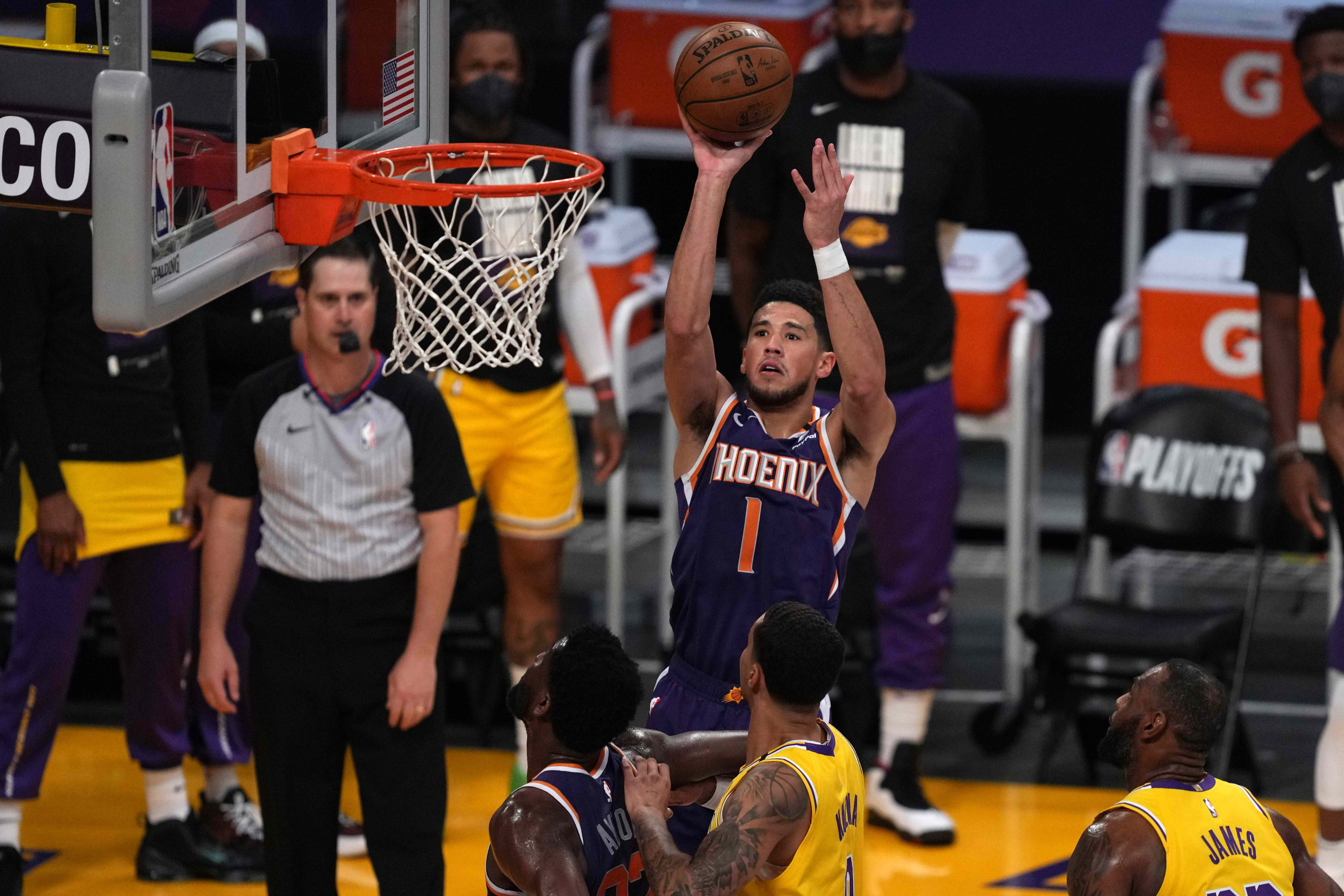 Booker, Suns explode early to eliminate Lakers