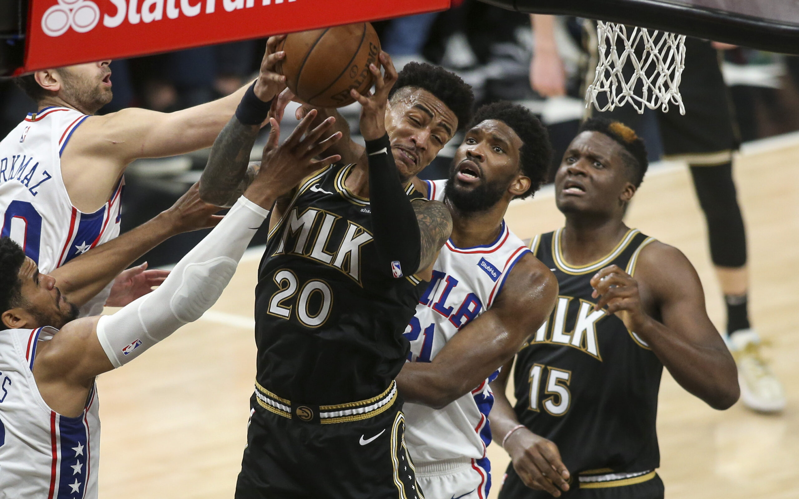 John Collins electric, Joel Embiid limited in Hawks' Game 4 victory