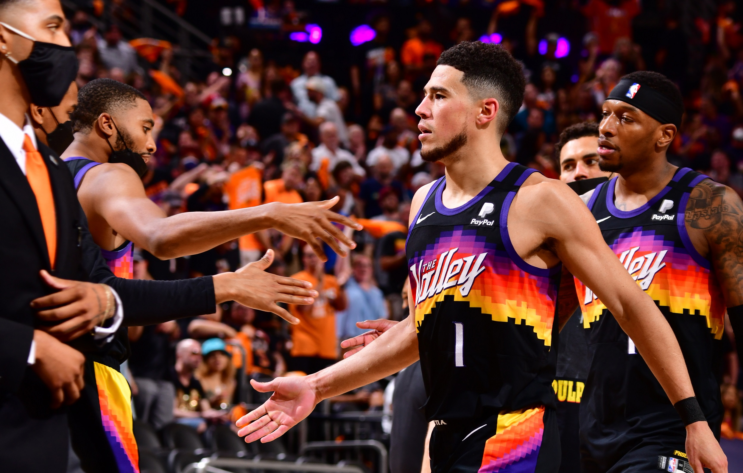 Booker's 40-point triple-double lifts Suns to victory