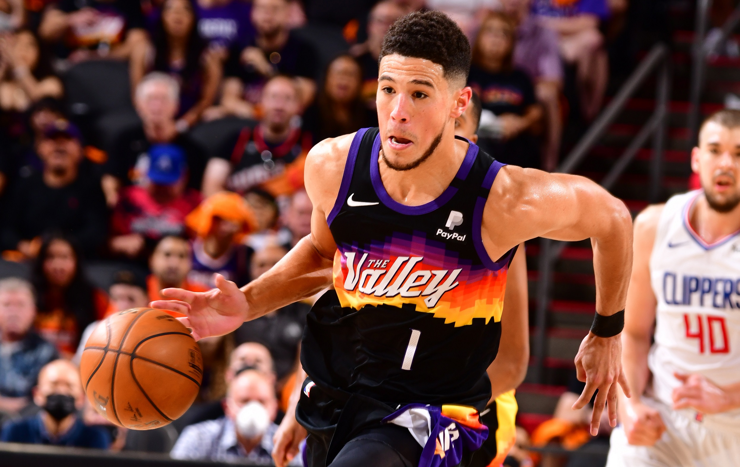 Booker's triple-double gives Suns Game 1 win