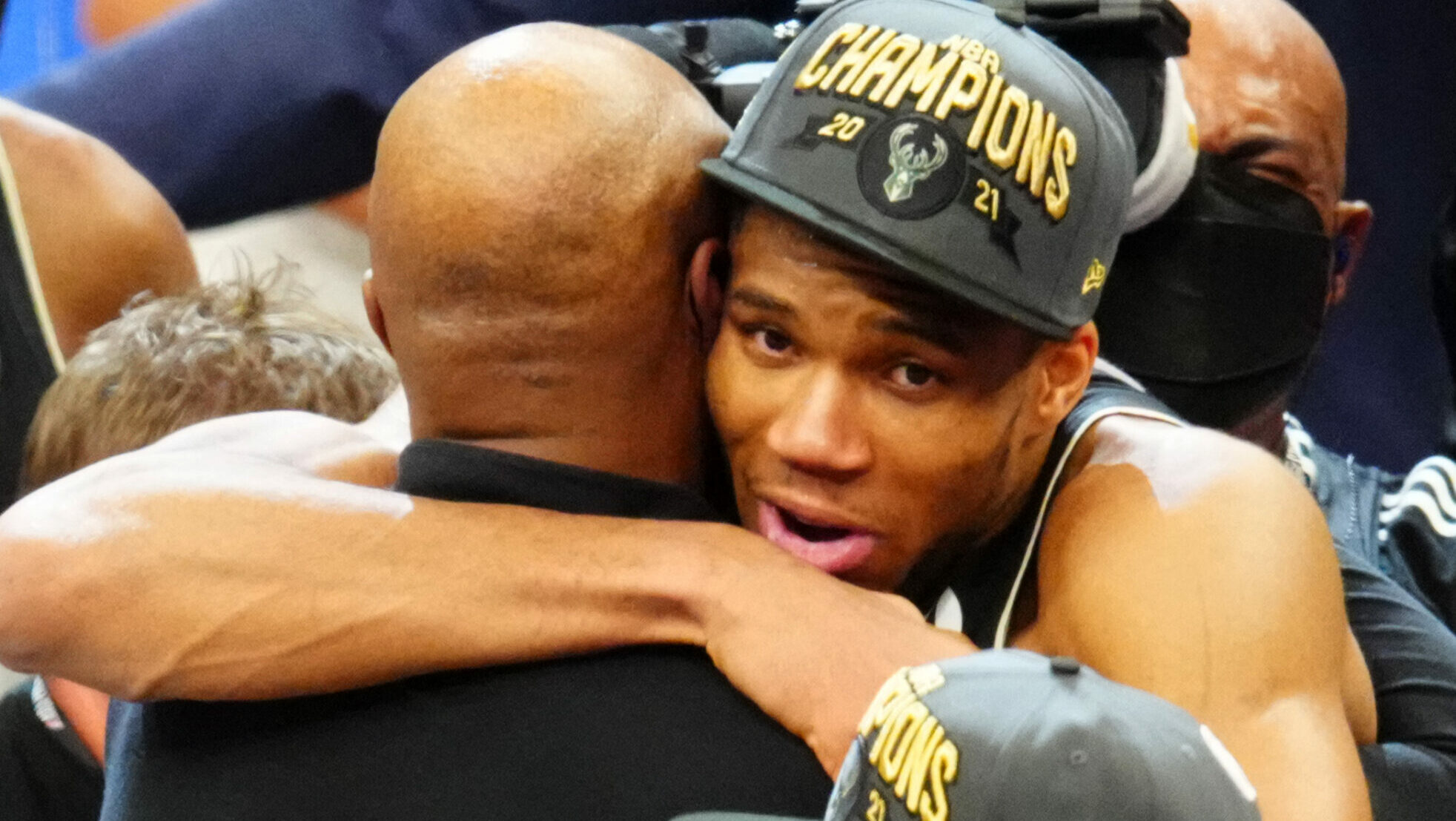 Giannis' biggest fans watch, celebrate title a world away
