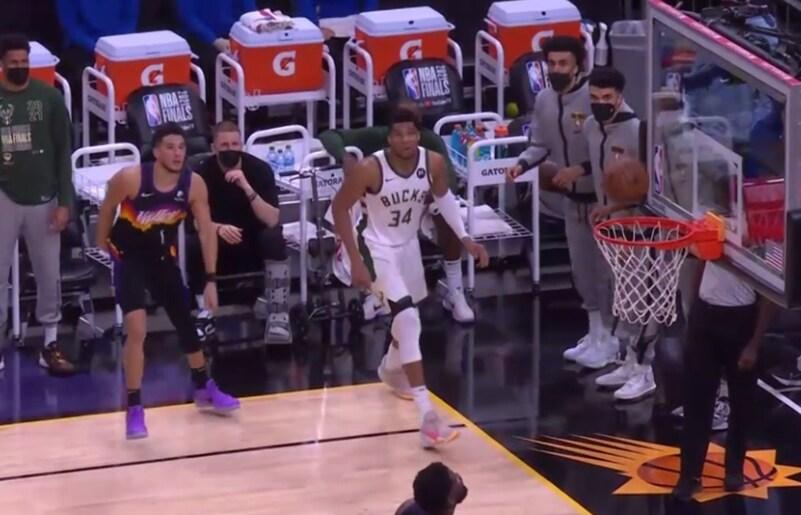 Devin Booker fires the jumper over Giannis