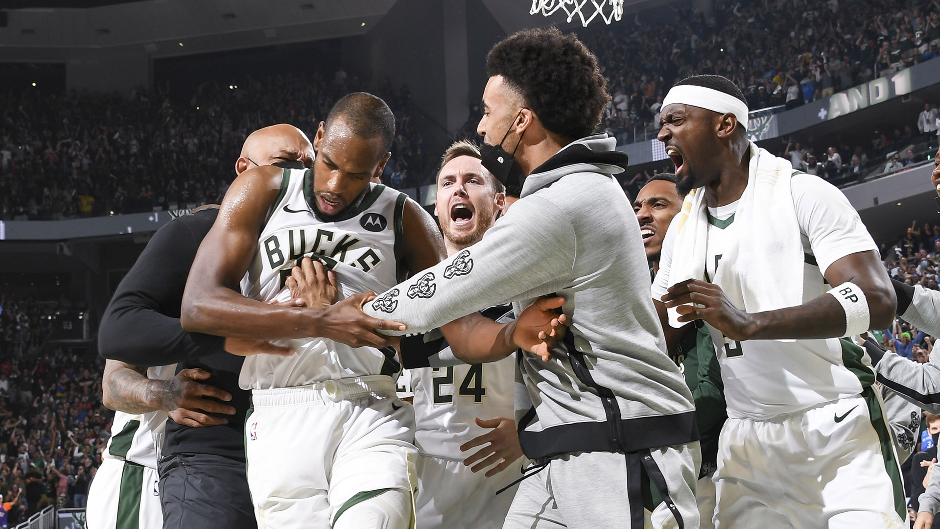 Bucks fend off Booker, Suns to pull even