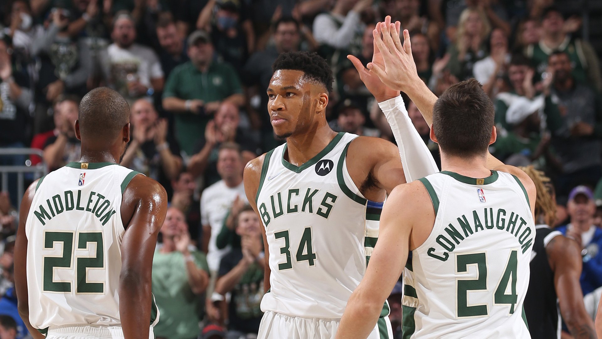 Bucks open title defense with resounding win over Nets