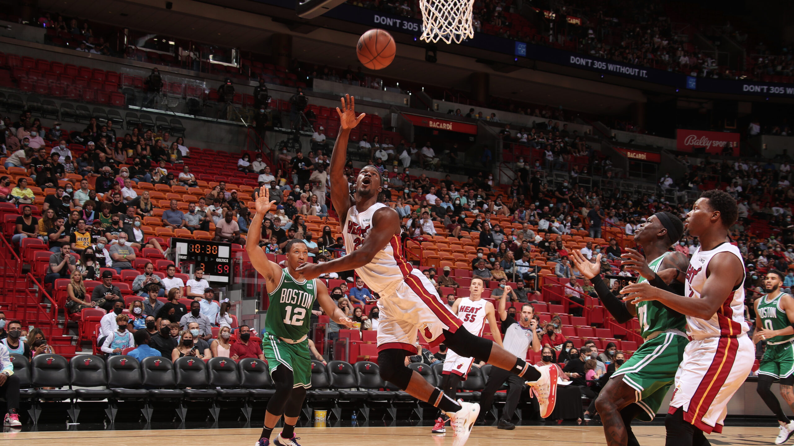 Butler, Herro help Heat pull away late to beat Boston